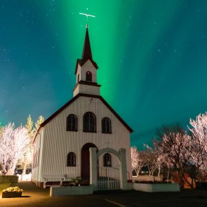 Northern lights above an icelandic church