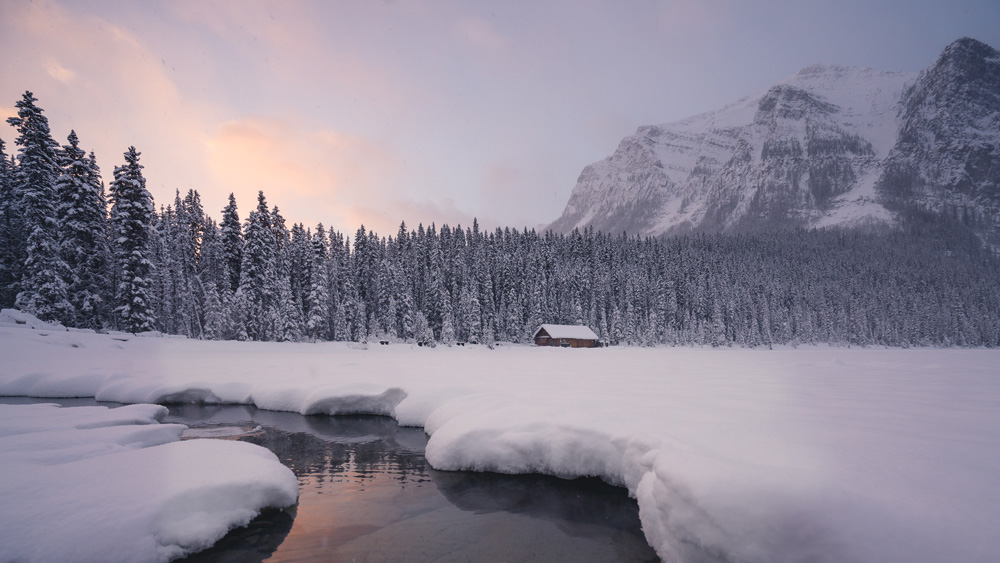 Sunrise storm at Lake Louise by Jeff Bartlett Media Inc.