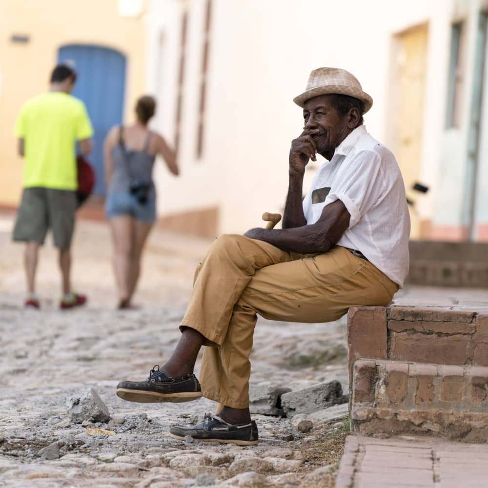 Using a telephoto lens, I was able to blur the background behind this man in Cuba and make the most of a situation I could not control